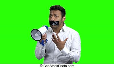 Emotional man with taped mouth.