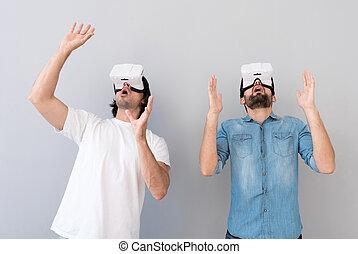 Emotional men using virtual reality device