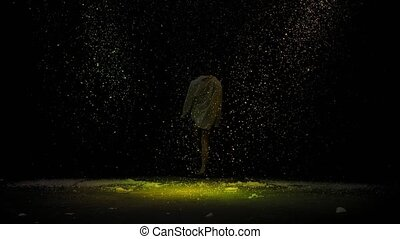 Emotional performance of contemporary choreography or modern ballet. A silhouette of a man against the background of falling snow in the rays of studio light. Winter's tale. Slow motion