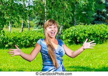 emotional portrait of a surprised young girl outdoors