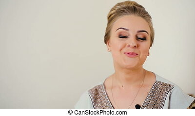Emotional portrait of businesswoman talking to camera
