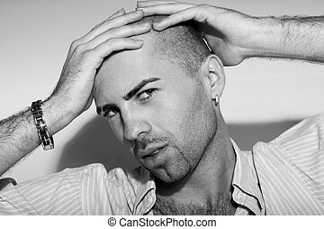 Emotional portrait of the bald guy in studio