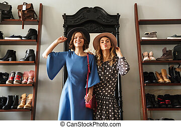 Emotional pretty young women indoors in showroom