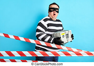 emotional puzzled prisoner with safe posing to the camera