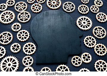 Emotional quotient EQ. Head silhouette and gears around.