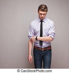 emotional shot of walking guy in formal wear