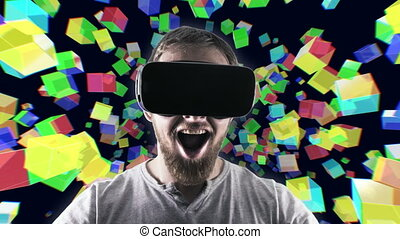 Emotional smile happy man wearing virtual reality goggles. VR headset. Within virtual space cubes black