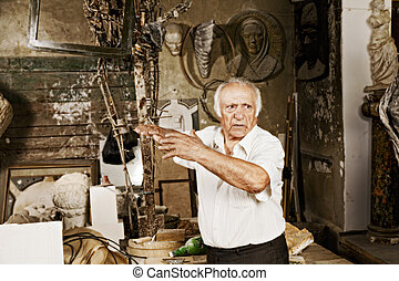 Emotional story - Old sculptor tells emotional story at his...