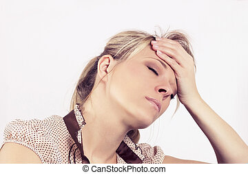 Emotional Stress, Headache, Woman at home on the sofa