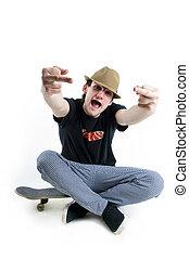 Emotional teenager sitting on skate isolated on white ...
