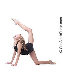 Emotional young gymnast posing in studio