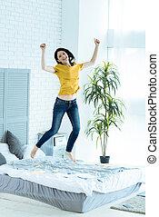 Emotional young woman celebrating success