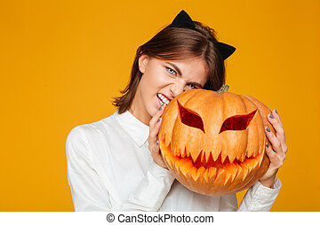 Emotional young woman dressed in crazy cat halloween costume