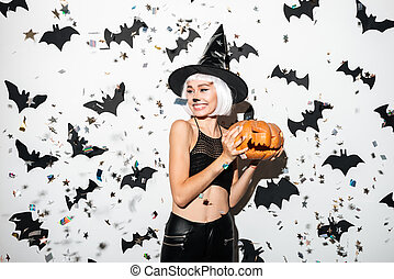 Emotional young woman in halloween costume