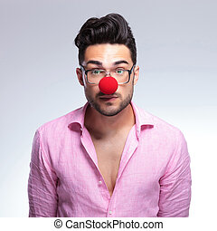 emotionless fashion young man with red nose - closeup of a...