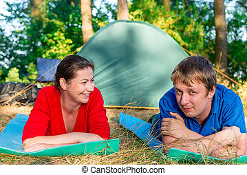 emotions couple on vacation in the summer camping
