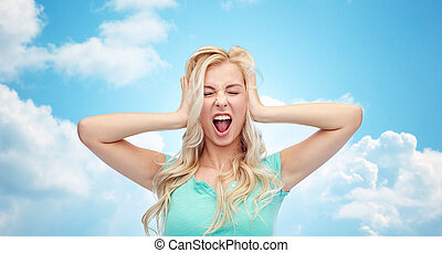 young woman holding to her head and screaming