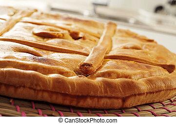 empanada gallega, savory stuffed cake typical of Galicia, ...