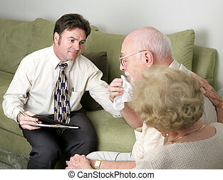 Empathy - A counselor helping a grieving couple. The husband...