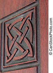 emphasis on design - fragment beautiful carved brown wooden...