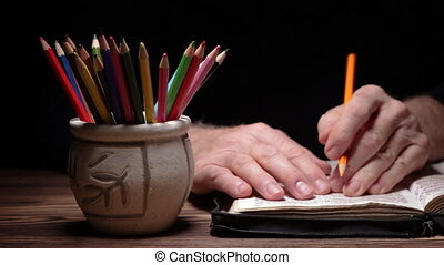 Emphasizing sentences in the Holy Bible - Hand taking a ...
