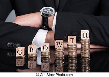empilhado, moedas, blocos, crescimento, homem negócios
