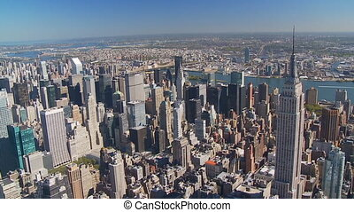 aerial view of empire state building and skyscrapers of manhattan part II of IV