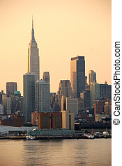 Empire State Building in the morning in Manhattan, New York City over Hudson River