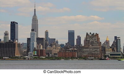 Empire State Speed Boat - A speed boat moves up the Hudson...