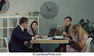 Employee answering phone call during meeting - Lovely blonde...