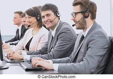 employee call center with headset at workplace - operator...