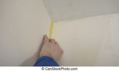 Employee glue tape on the wall. Slow motion