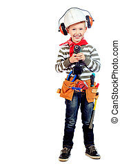 employee - Little boy in a helmet plays in the builder with...