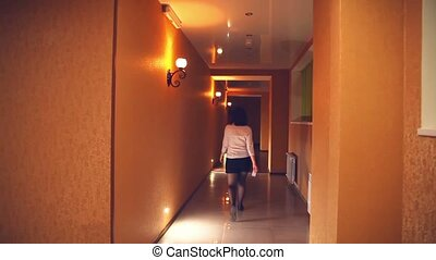 employee of hotel manager is woman in the evening along the...