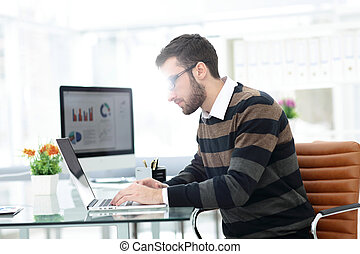 employee of the company working on laptop