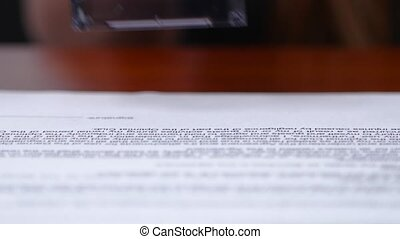 Employee puts at the bottom of the rectangular document printing. Close up