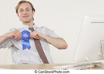 Employee recognition - professional man sitting at desk with...