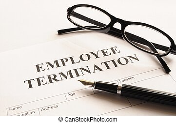 employee termination form on desk in business office showing...