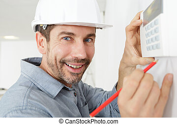 employee working with thermostat