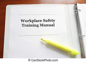 Employee Workplace Safety Training Manual on a desk with highlighter