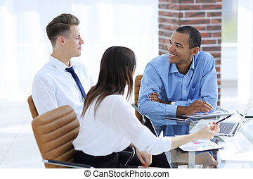 employees discussing new ideas in the workplace