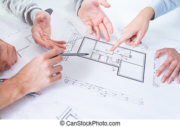 Employees discussing project in the office