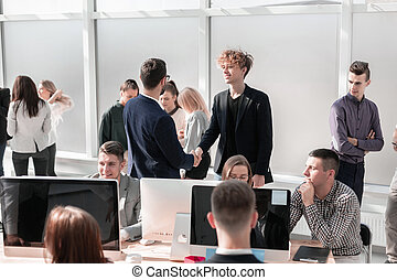 employees discussing work issues in the office