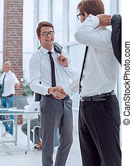employees of the company greeting each other with a handshake.