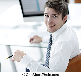employee,sitting in front of the laptop