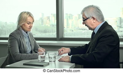 Employer Criticizing - Side view of business people talking...