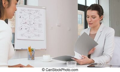 employer having interview with employee at office - job,...