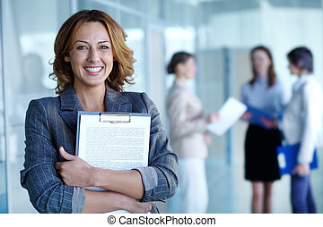 Employer - Image of pretty businesswoman with document...