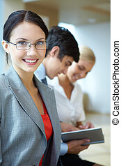 Employer - Portrait of happy businesswoman smiling at camera...