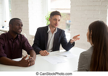 Employers talking to female employee considering her resume